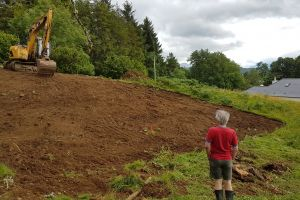 First topsoil layer removed; Mike looking, and feeling, very small at the start of a very big project