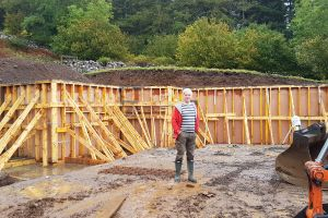 Earth-Retaining Wall: Mike stands in front of the shuttering