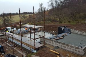 Scaffolding starts to go up ready for steel installation; upper ground floor foundations prepared