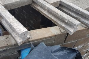 The ends of the floor beams rest on the inner leaf of blockwork, held in place by mortar