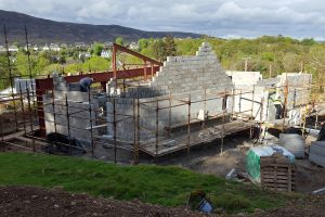 With the walls at the western end at roof height, work continues to build up the walls at the eastern end