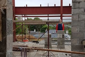Standing in the unfinished porch, looking through what will be the entrance hall and on into the main room you can see that you will get a tantalising glimpse of the view as you enter the building