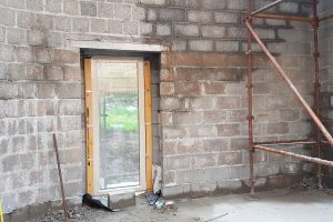 The window in the east-facing wall of the kitchen has been installed