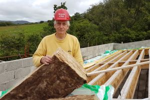 At the weekend, Mike is back on insulation duty on the roof