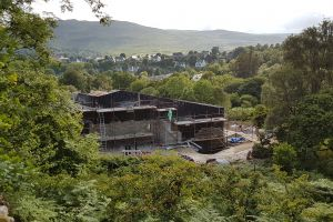 Seen here from the viewpoint on the Scorrybreac path, the house is really beginning to take shape. It's a good place from which to see the progress on the stone-cladding