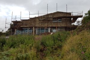 At the start of September the stonework on the south-facing wall is almost complete and the house is beginning to look very nice indeed.