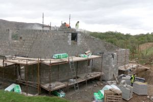 In May the brick-layers, Tommy and Steve, get to work on the north and east walls of the house