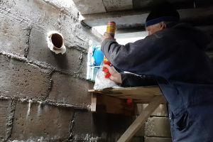 Any gaps too small to fill with insulation are sealed using expanding foam - as can be clearly seen around the services pipe to the left of the MVHR tubes