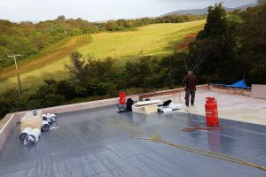 The Alvitra has a special adhesive backing that bonds with the the insulation beneath it and provides a tough, fully watertight covering. It is often used as the final covering on flat roofs; ours will have soil and grasses on top.